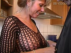 Hot german mom in fishnets makes him cum in in the kitchen