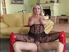 Busty blonde rides big dick with black stockings