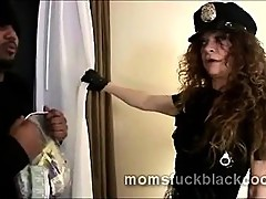 Beautiful mature police officer catches big black dong