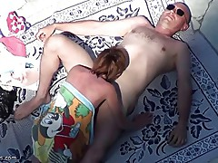 Mature suck cock at the nude beach