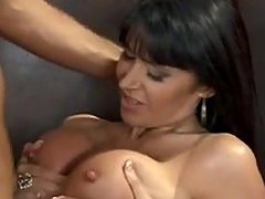 Bigtitted Milf Eva KarEra squeezes A Lucky Fellow\'s nob between this chabr juicylicious jugs
