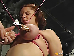 On her tied tits touches clothespins