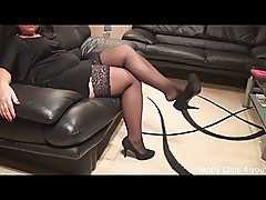 Black stockings and shoe dangling