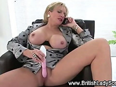Lingerie wearing slut gets a dildo in her while watching tv