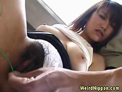 Asian milf whips out a sex toy to rub her clit hard