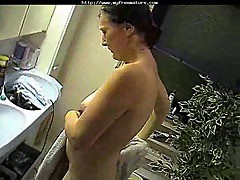 Mature takes shower