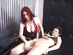 Dominatrix redhead torments her sexy slave\'s shaved pussy