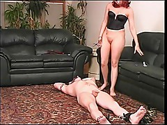 Horny redhead plays around with her slaves dick