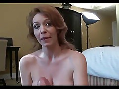 Redhead milf getas blackmailed to give a handjob