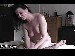 Amazing horny lady masturbates a lucky mans cock while on the bed