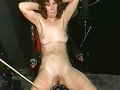 Mom slave with great body gets serveral needles up her ass a