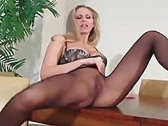 Twat teasing through pantyhose