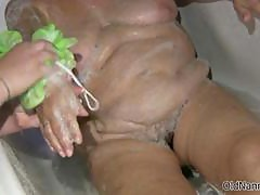 Nasty old woman gets to be washed by a nurse