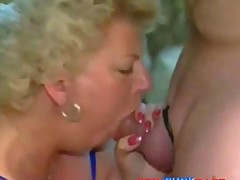Older blonde lady ready to sit on a cock