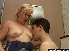 Older dame giving a sex lesson