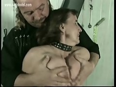 Mature slave gets hits on her pussy and pulled on her nipples bdsm
