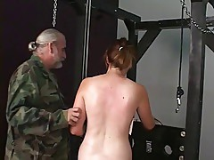 Cute brunette slave girl gets restrained for clamp play on her shaved pussy