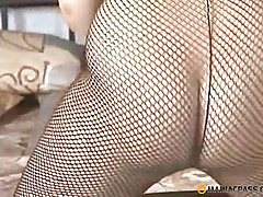 The girl feels the her pussy through pantyhose