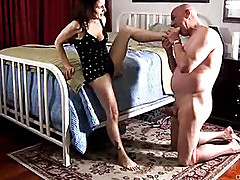 Gorgeous cougar gives a great foot job and sucks cock for a mouthful of cum