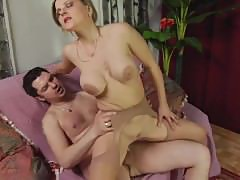 Busty mature gets creamed by young lover