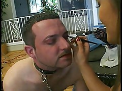 Femdom Asian gets her strapon sucked by man slave