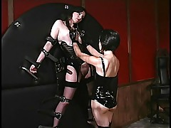 Asian dominatrix playing with the slave\'s pussy