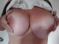 Busty MILF shows off the twins