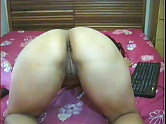 Latina milf fucks her wet ass and pussy with dildo.