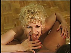 Shorthaired blonde mature pleases cock with her wet mouth