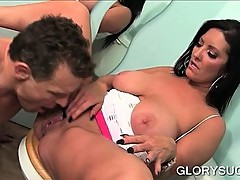 MILF giving titjob and eating dick on gloryhole