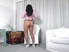 Big booty brunette teasing in fencenet pantyhose