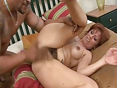 Mature brunette gets her hairy pussy eaten