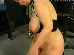 Fat milf slave gets metal clamps on her large tits by masked