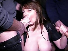 Busty brunette milf gets into a bukkake session in group sex