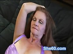 Horny redhead granny fucks her shaved pussy with a dildo