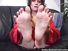 Fierce MILF demands your tongue on her feet