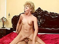 Lusty grandma enjoys hard sex with a boy